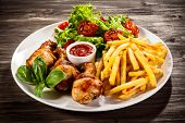 image of turkey-hen  - Grilled chicken drumsticks with chips and vegetables - JPG