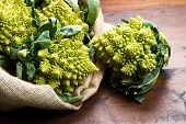 picture of romanesco  - a group of Romanesco broccoli cabbage on wood - JPG