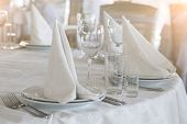 image of wedding table decor  - Tables set and salad served for a wedding reception - JPG