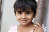 foto of indian  - Standing Innocence Indian Rural Girl Looking at Camera - JPG