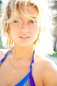 Sunny Woman. Attractive Blond Woman Enjoy Summer Sun