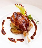 picture of roast duck  - Duck pestle with potato and garlic - JPG