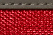 foto of stitches  - close up of red fabric material detail stitched to another material - JPG