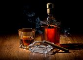 picture of cigar  - Brandy and cigar on ashtray on a wooden table - JPG