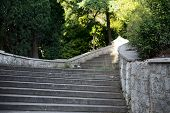 picture of bannister  - Ancient staircase in an abandoned park on a sunny day - JPG