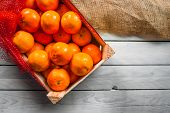 stock photo of clementine-orange  - Clementine fruits in a box on a table - JPG