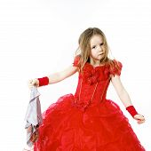 picture of cinderella  - Young cinderella dressed in red preparing to mop the floor by dirty cloth - JPG