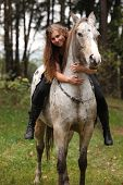 image of appaloosa  - Beautiful girl riding a horse without bridle or saddle in autumn