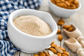 picture of ground nut  - Almond flour and dry nuts on a wooden table  - JPG