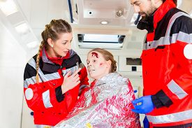 foto of accident victim  - Emergency doctor and paramedic or ambulance team helping accident victim  - JPG