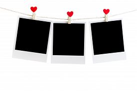 picture of clotheslines  - Three Old picture frame hanging on the clothesline over white Clipping path for insert Photo - JPG
