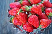 stock photo of strawberry  - fresh strawberry on a table red strawberry on the wooden table - JPG