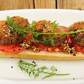 picture of sesame seed  - Lentil patty sandwich with tomato sesame seeds and carrot greens square - JPG