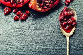 stock photo of pomegranate  - Pieces and grains of ripe pomegranate - JPG