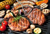 foto of barbecue grill  - Assorted delicious grilled meat with vegetable over the coals on a barbecue - JPG