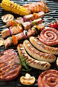 pic of barbecue grill  - Assorted delicious grilled meat with vegetable over the coals on a barbecue - JPG