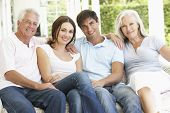 image of grown up  - Portrait Of Mature Parents Relaxing With Grown Up Children - JPG