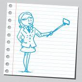 foto of selfie  - Businesswoman taking selfie with selfie stick - JPG