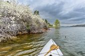 image of horsetooth reservoir  - canoe bow with a wooden paddle on Horsetooth Rerservoir - JPG