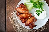 stock photo of chicken wings  - Baked chicken wings with teriyaki sauce on wooden table - JPG