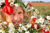 Outdoor Portrait Of Smiling Girl With Flowers