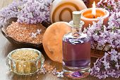 pic of essential oil  - Aromatherapy essential oil brown sugar sea salt natural soap and lilac flower - JPG