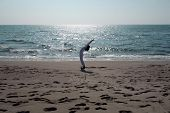 pic of salute  - yoga Sun Salutation sequence on a shore - JPG
