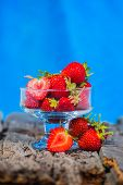 picture of ice cream parlor  - Strawberry ice cream with wooden and blue background - JPG