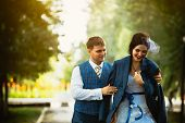 stock photo of cold-shoulder  - photo of groom hugging bride at cold day - JPG