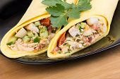 image of shawarma  - Close up of Shawarma with chicken in black plate on wooden bamboo table - JPG