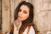 stock photo of mehendi  - Portrait of a young indian woman in casual style with mehendi on the streets of old city - JPG