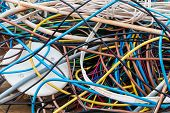 stock photo of landfills  - Scrap cable in a waste landfill background - JPG