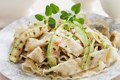 stock photo of oregano  - Italian zucchini pasta with oregano and parmesan cheese - JPG