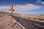 stock photo of canary  - Long Empty Desert Asphalt Road in Canary Islands Spain - JPG