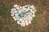 picture of heart sounds  - Bass guitar on the heart stone - JPG