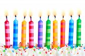 pic of birthday-cake  - Ten birthday cake candles against a white background - JPG