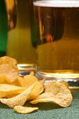 stock photo of potato chips  - potato chips and beer - JPG
