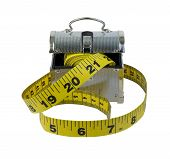 pic of lunch box  - Measuring tape with ticks and numbers to measure items with a metal lunch box  - JPG