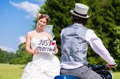stock photo of scooter  - Wedding groom pick up bride with motor scooter having fun - JPG