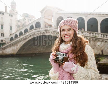Woman Tourist With Retro Camera