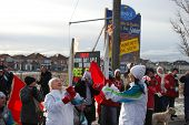 MILTON, CANADA - DECEMBER 19: Passing of the flame between two torch bearers during the Olympic Torc
