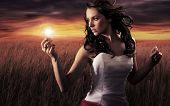 foto of light-bulb  - Woman holding a light bulb - JPG