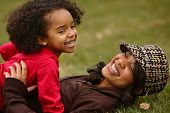 stock photo of mother child  - girls having lot of fun in a local park - JPG