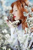 Portrait of beautiful redheaded girl in spring