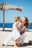 stock photo of summer fun  - Happy family resting at beach in summer - JPG