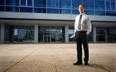 stock photo of front door  - asian businessman in front of his corporate - JPG