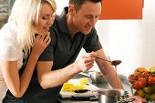 foto of strawberry blonde  - Young couple cooking  - JPG