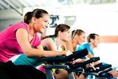 stock photo of gym workout  - Group Of Four People In The Gym - JPG