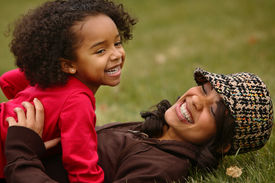 image of mother child  - girls having lot of fun in a local park - JPG