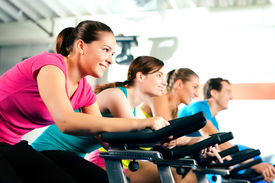 stock photo of cardio exercise  - Group Of Four People In The Gym - JPG